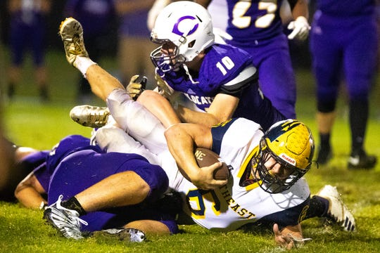 Devon Dillehay (6) of Northeast gets blocked when running the ball during the second half at Clarksville High Friday, Sept. 28, 2018, in Clarksville, Tenn.