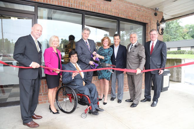 From left: Assemblyman James Kennedy, Somerset County Freeholders Patricia Walsh and Patrick Scaglione, Green Brook Mayor Patrick Boccio, Allies CEO Elise Tretola, Freeholder Mark Caliguire, Seniore Vice President of Public Affairs for Allies Donald Tretola and Mike Kerwin of the Somerset County Business Partnership at the ribbon cutting of Greensleeves Bake Shop on Route 22 in Green Brook.