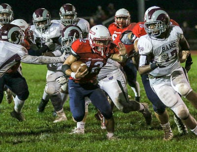Dunellen running back Jacob Sanders (12) runs his way to a touchdown against South River on Friday, Sept. 28, 2018.