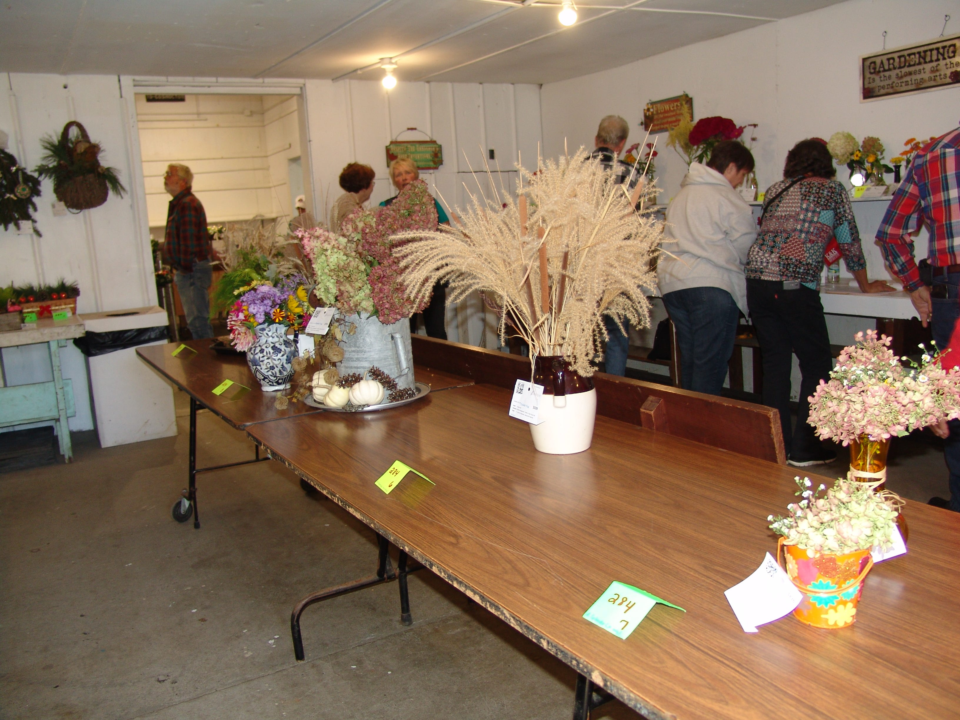 Visitors gather in the Art Hall during judging in various floral divisions.