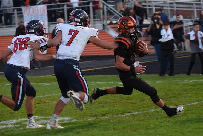 Ridgewood freshman quarterback Game Tingle (right) scores the first touchdown of Friday night's game against defense from Indian Valley's Solomon Cox (left) and Cade Williams (center). The Generals won 34-22.