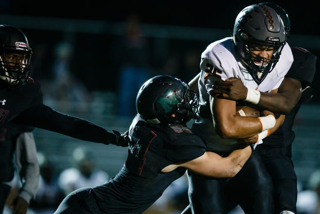 Council Bluff, Thomas Jefferson's Cameron Baker (25) rushes during their football game at Des Moines North on Friday, Sept. 28, 2018 in Des Moines.