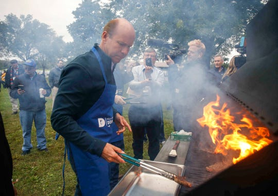 Democratic presidential hopeful John Delaney flips steaks during the 2018 Polk County Steak Fry on Saturday, Sept. 29, 2018.