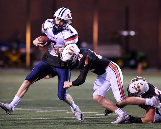 Urbandale Quarterback Ty Langenberg (7) scramble as Valley's Jon Shaner (22) comes in for a tackle on Friday, Sept. 28, 2018 during a football game between the Valley Tigers and the Urbandale J-Hawks at Valley Stadium.
