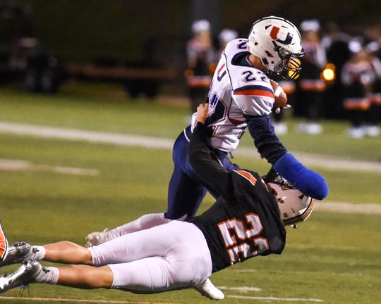 Valley's Jon Shaner (22) tries to tackle Urbandale's Brook Heinen (22) on Friday, Sept. 28, 2018 during a football game between the Valley Tigers and the Urbandale J-Hawks at Valley Stadium.