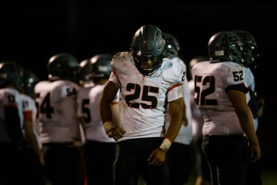 Council Bluff, Thomas Jefferson's Cameron Baker (25) walks off the field with an injury during their football game at Des Moines North on Friday, Sept. 28, 2018 in Des Moines.