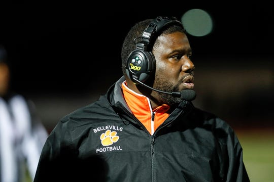 Belleville head coach Jermain Crowell watches a play against Dearborn Fordson during the first half of an MHSAA football game at Belleville High School in Belleville, Friday, September 28, 2018.