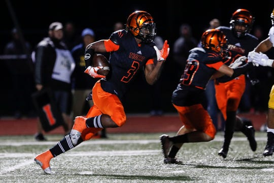 Belleville wide receiver Julian Barnett (3) runs against Dearborn Fordson during the first half of an MHSAA football game at Belleville High School in Belleville, Friday, September 28, 2018.