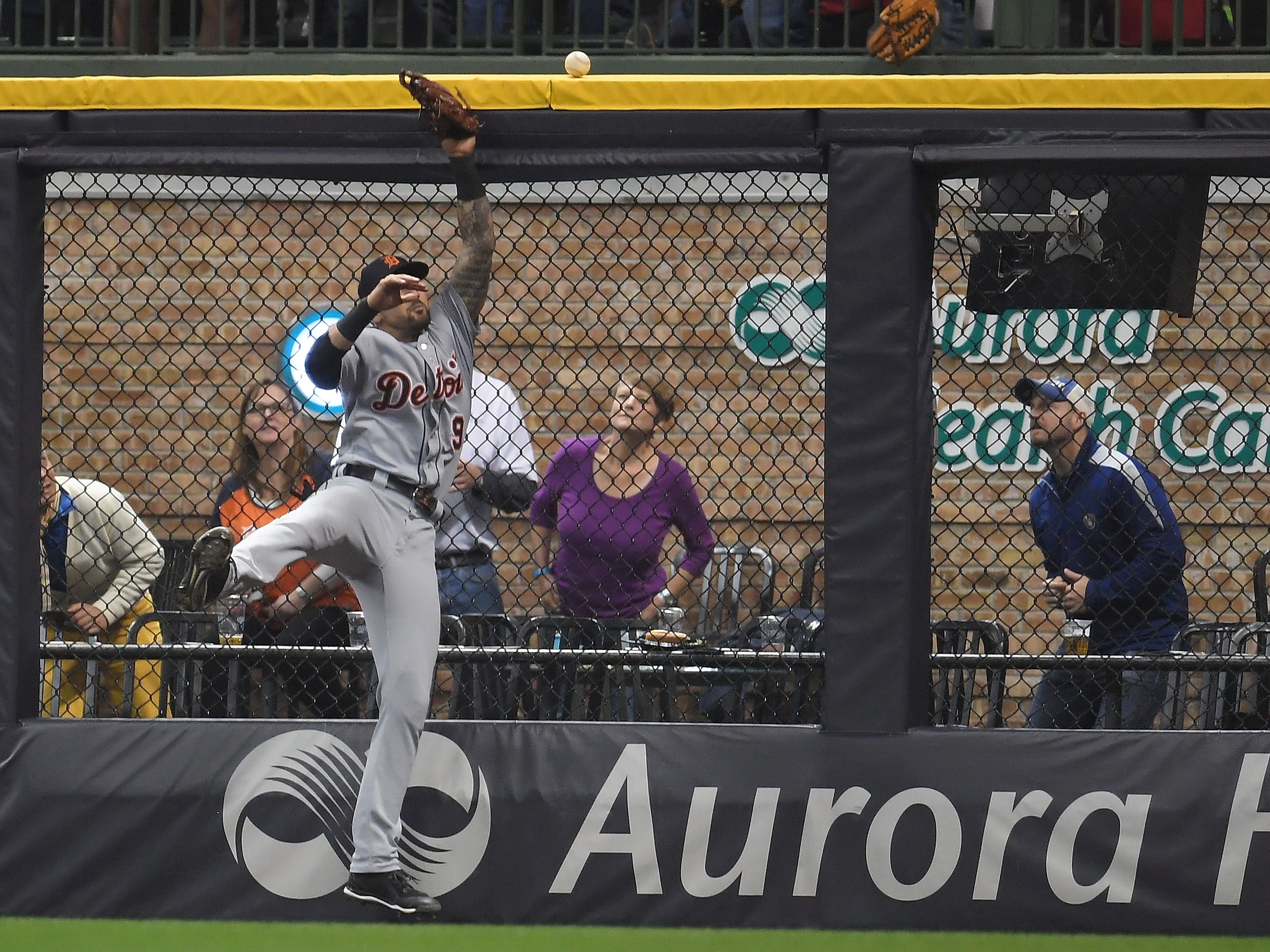 Detroit Tigers RF Nicholas Castellanos is unable to catch a home run hit by the Milwaukee Brewers' Ryan Braun during the eighth inning Friday, Sept. 28, 2018, in Milwaukee.