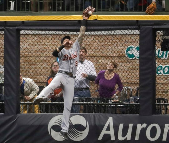 Detroit Tigers' Nicholas Castellanos can't catch a home run by the Milwaukee Brewers' Ryan Braun during the eighth inning Friday, Sept. 28, 2018, in Milwaukee.