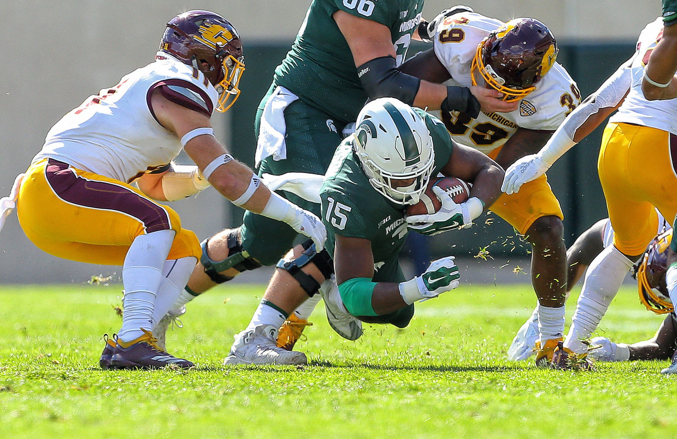 Michigan State running back La'Darius Jefferson is tripped against Central Michigan during the first half on Saturday, Sept. 29, 2018, at Spartan Stadium.