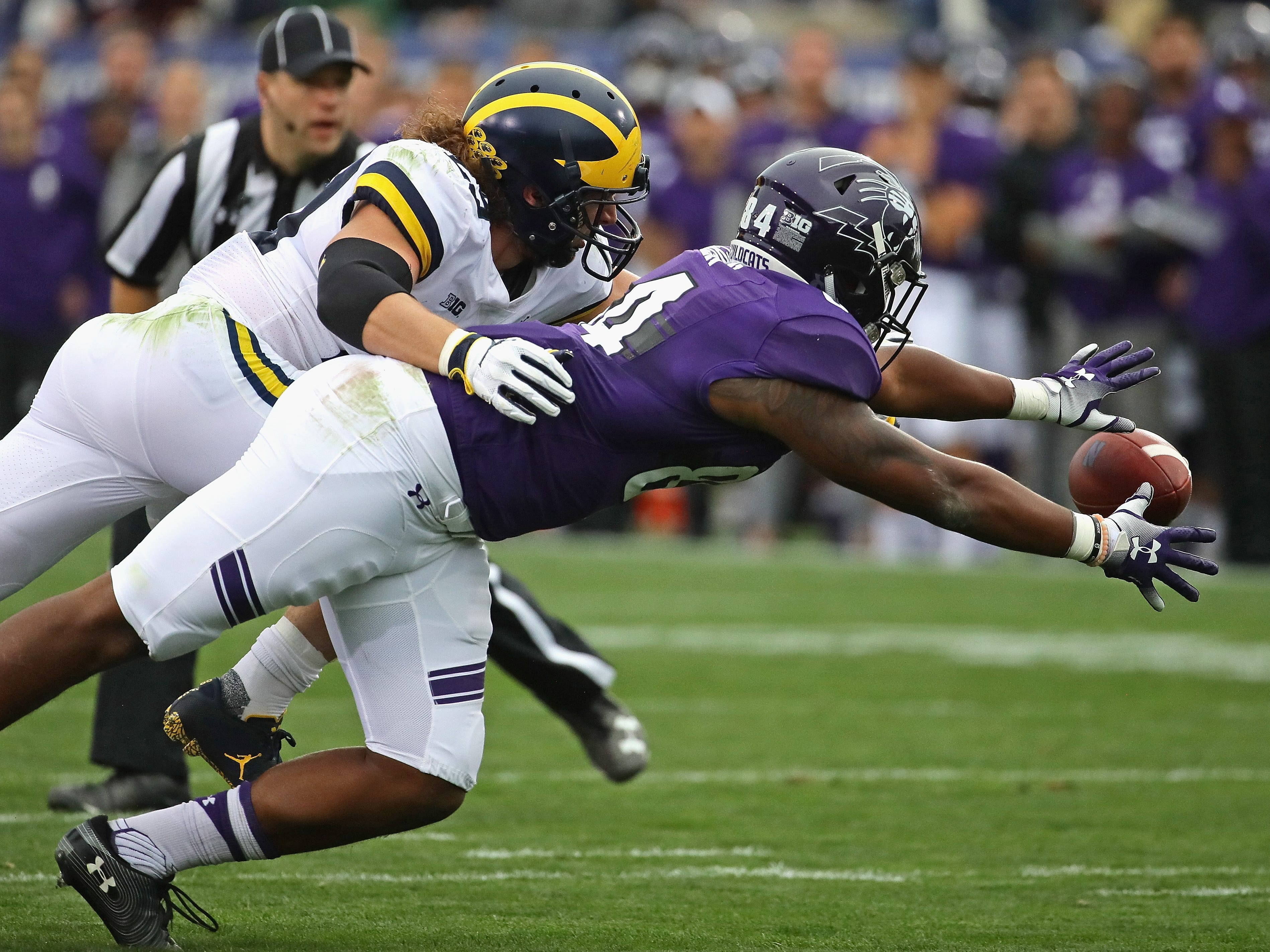 Northwestern's Cameron Green tries to catch a pass defended by Michigan's Jordan Glasgow at Ryan Field on Sept. 29, 2018 in Evanston, Ill.