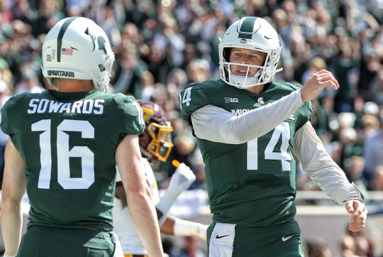 Michigan State quarterback Brian Lewerke celebrates after a touchdown run against Central Michigan during the first half on Saturday, Sept. 29, 2018, at Spartan Stadium.