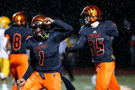 Belleville quarterback Christian Dhue-Reid (1) and wide receiver Christopher Zaharie (85) celebrates a touchdown against Dearborn Fordson during the second half of an MHSAA football game at Belleville High School in Belleville, Friday, September 28, 2018.