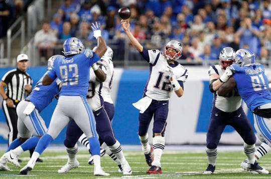 Tom Brady throws the ball over defensive lineman Da'Shawn Hand in the first quarter Sept. 23.