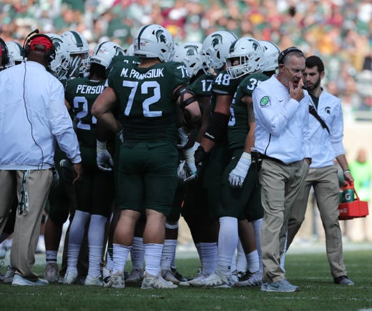 Mark Dantonio, Michigan State huddle