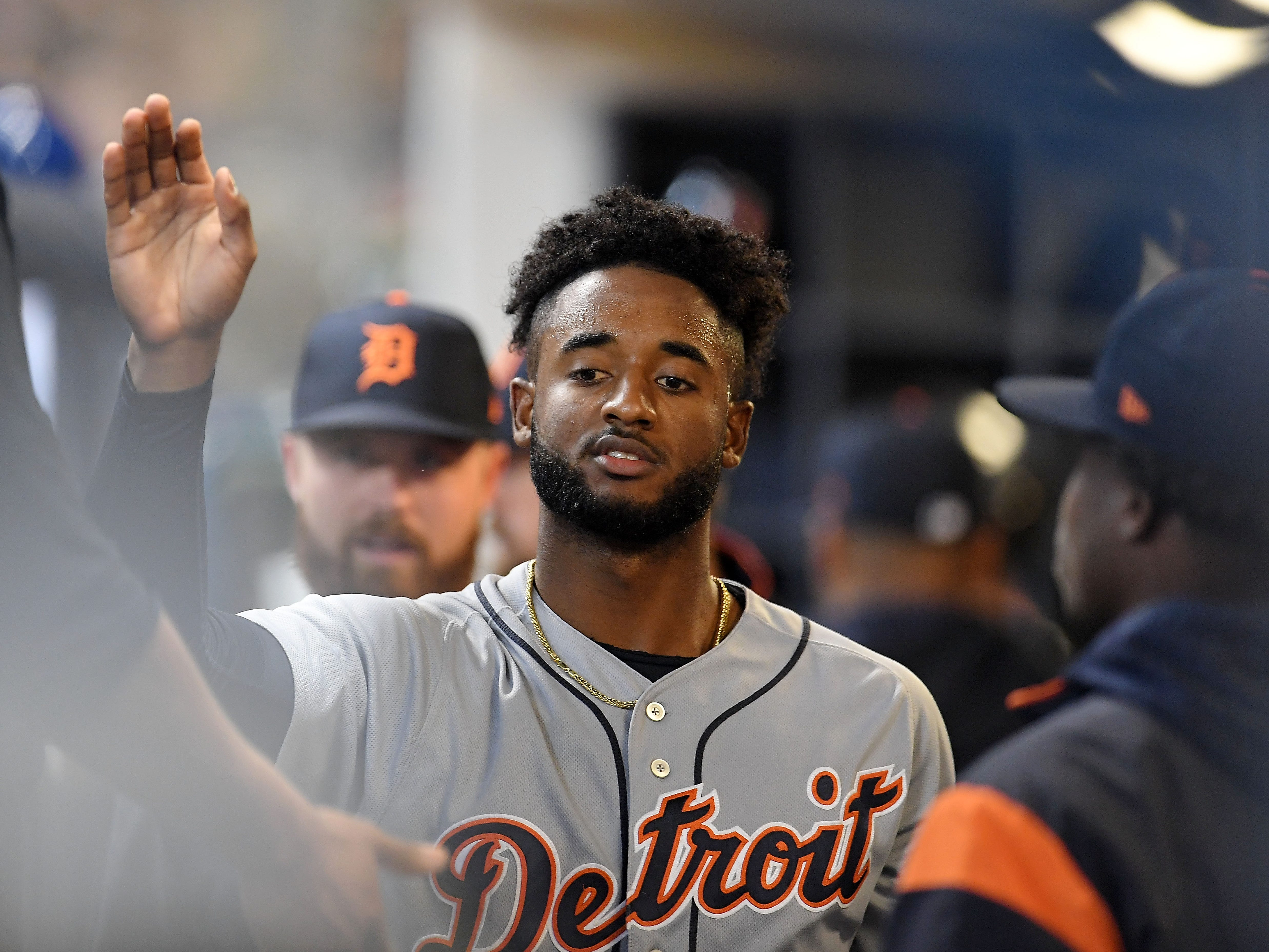 Niko Goodrum of the Detroit Tigers is congratulated by teammates after scoring a run against the Milwaukee Brewers during the first inning at Miller Park on Sept. 28, 2018 in Milwaukee.