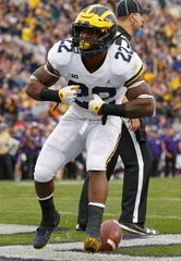 Michigan's Karan Higdon celebrates a touchdown against Northwestern during the first half Saturday, Sept. 29, 2018, in Evanston, Ill..