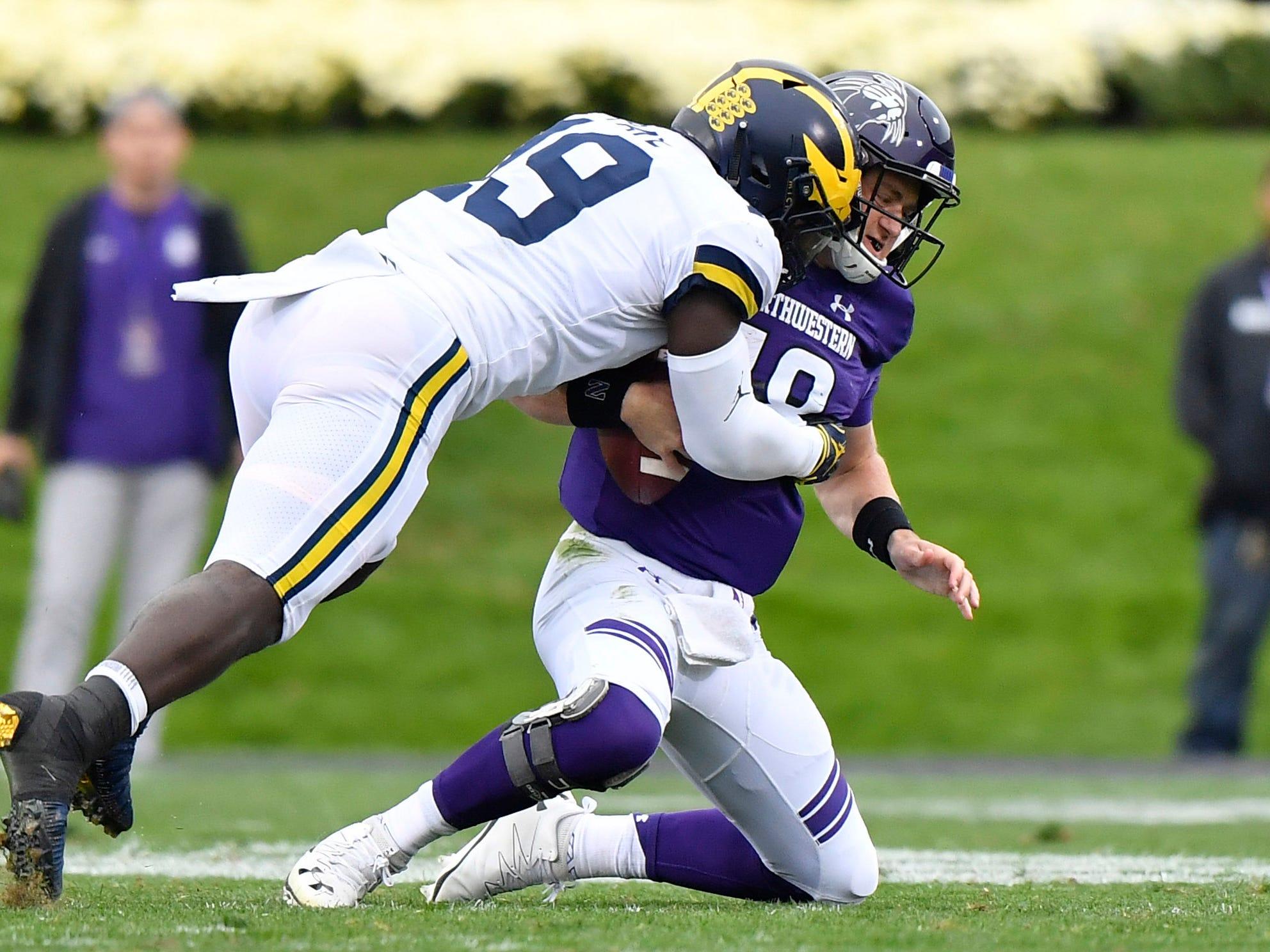 Michigan's Kwity Paye sacks Northwestern quarterback Clayton Thorson in the first half at Ryan Field on Sept. 29, 2018 in Evanston, Ill.
