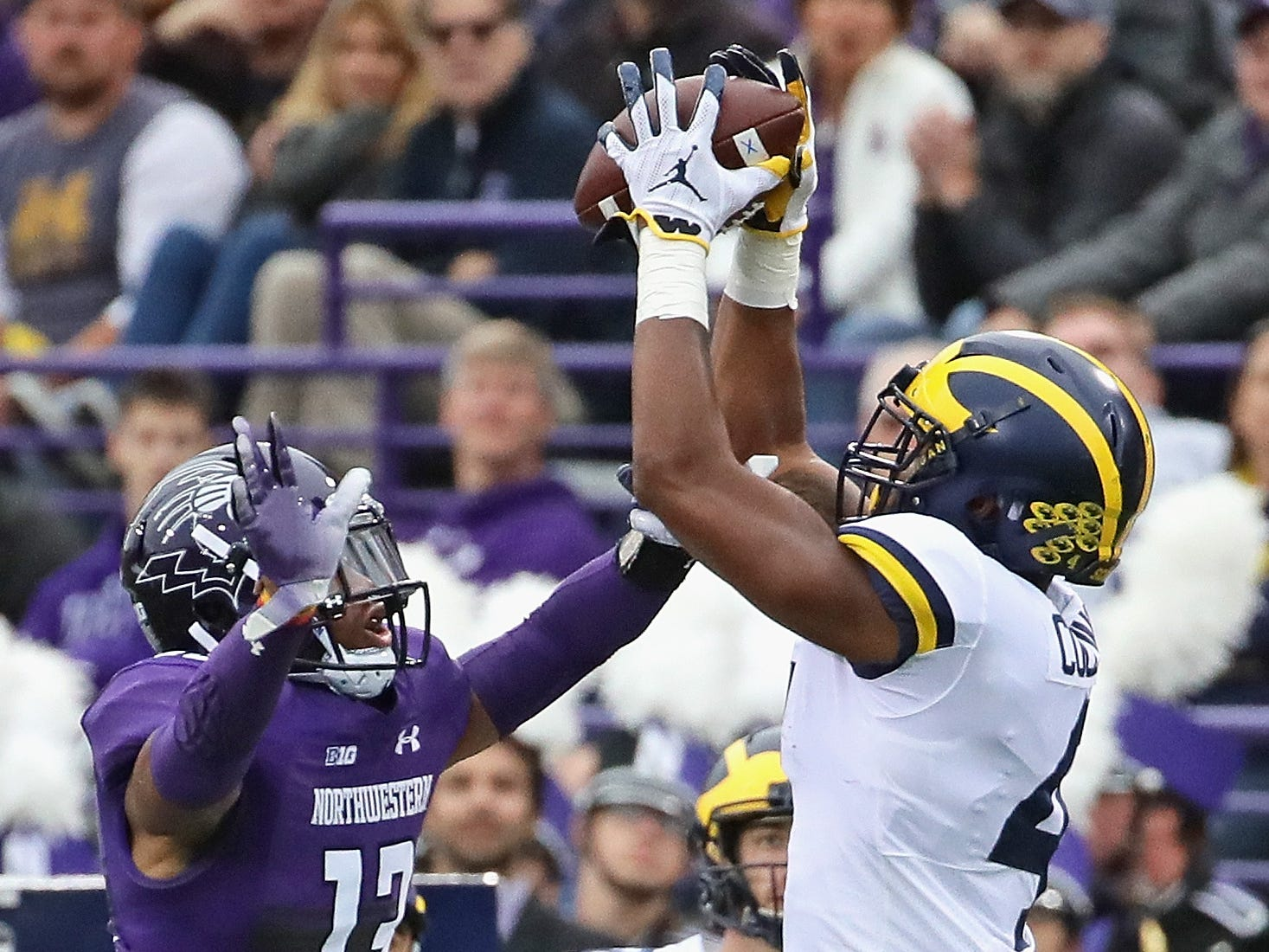Michigan's Nico Collins tries to catch a pass over JR Pace of Northwestern at Ryan Field on Sept. 29, 2018 in Evanston, Ill.