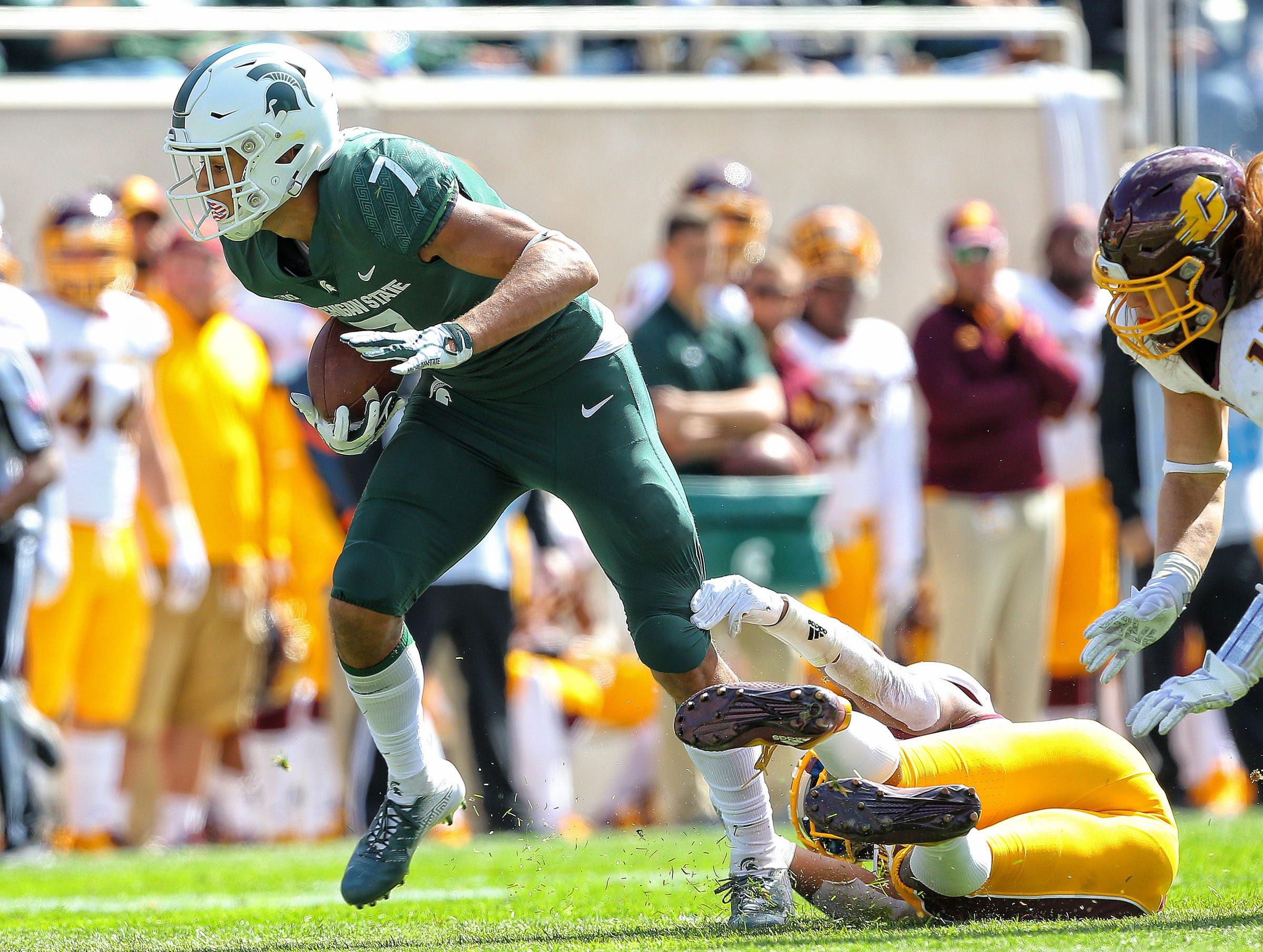 Michigan State wide receiver Cody White breaks a tackle against Central Michigan during the first half on Saturday, Sept. 29, 2018, at Spartan Stadium.