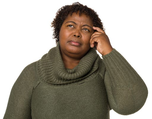 Confused Woman Scratching Head