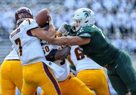 Central Michigan quarterback Tommy Lazzaro (7) is sacked by Michigan State defensive tackle Mike Panasiuk (72) during the first half on Saturday, Sept. 29, 2018, at Spartan Stadium.