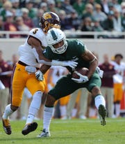 Michigan State receiver Cody White makes a catch against Central Michigan cornerback Sean Bunting during the first half Saturday, Sept. 29, 2018 at Spartan Stadium in East Lansing.