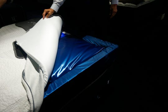In this June 26, 2018, photo City Furniture CEO Keith Koenig, shows the new waterbed on display in Tamarac, Fla.