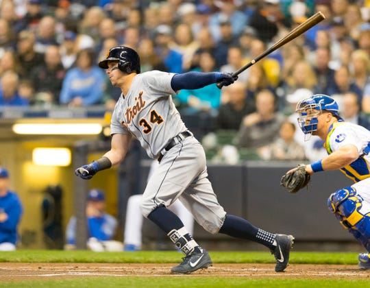 Detroit Tigers catcher James McCann hits an RBI single during the first inning against the Milwaukee Brewers at Miller Park on Sept. 28, 2018, in Milwaukee.