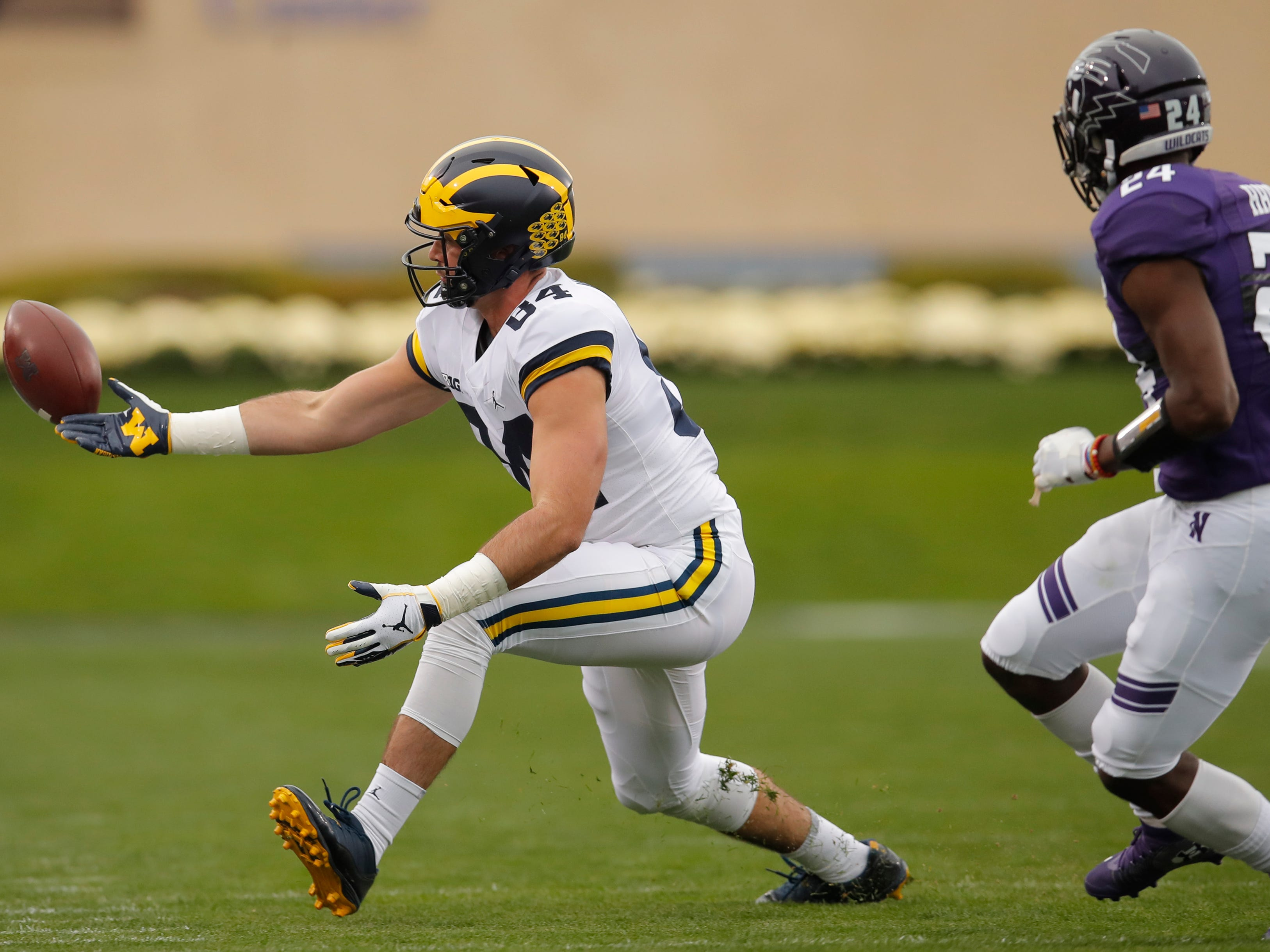 Michigan's Sean McKeon drops a pass as he is guarded by Northwestern's Montre Hartage during the first half Saturday, Sept. 29, 2018, in Evanston, Ill.