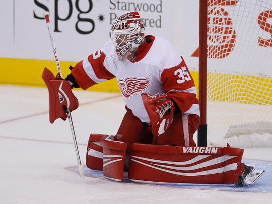 Detroit Red Wings goaltender Jimmy Howard makes a save during the warm up against the Toronto Maple Leafs at Scotiabank Arena in Toronto, Sept. 28, 2018.