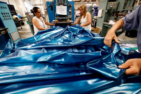 In this July 5, 2018, photo workers assemble the Afloat water bed at the factory in Corona, Calif.