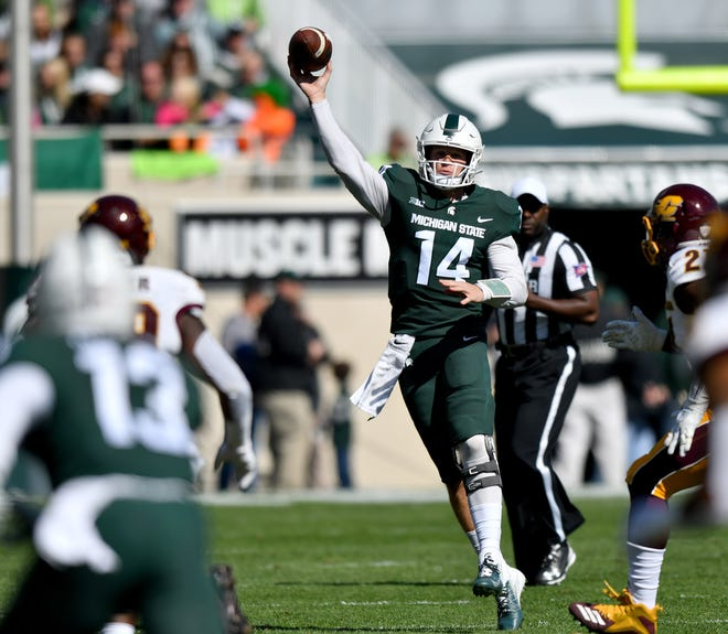Spartan quarterback Brian Lewerke throws to Laress Nelson in the first quarter.