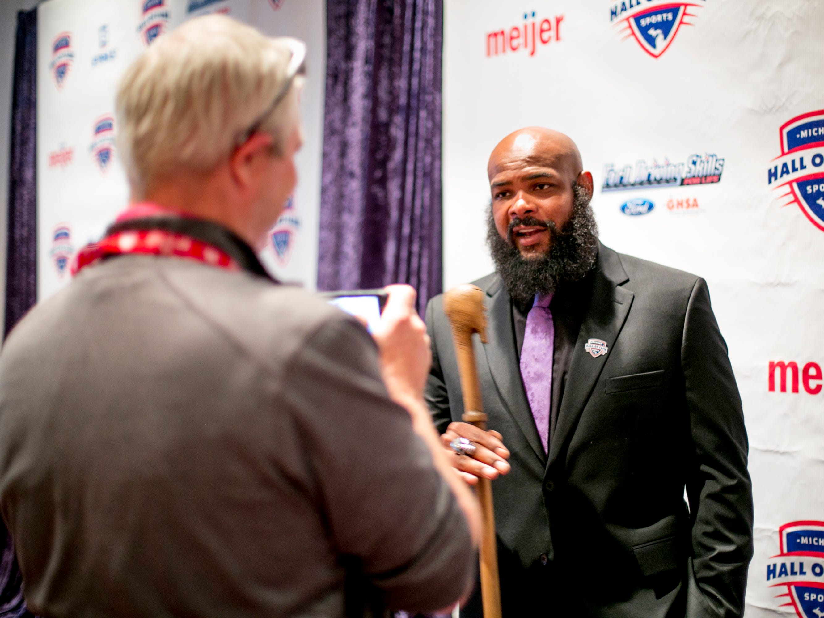 T.J.  Duckett speaks to the media before the ceremony.