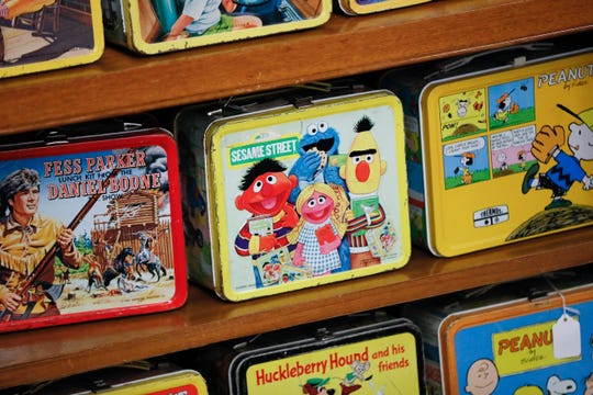 Vintage lunchboxes are displayed at Main Auction Galleries Inc., in downtown Cincinnati.