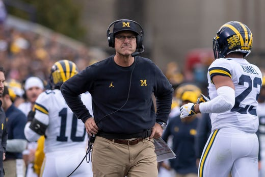 Michigan head coach Jim Harbaugh looks for answers after Northwestern scored a touchdown in the second quarter.