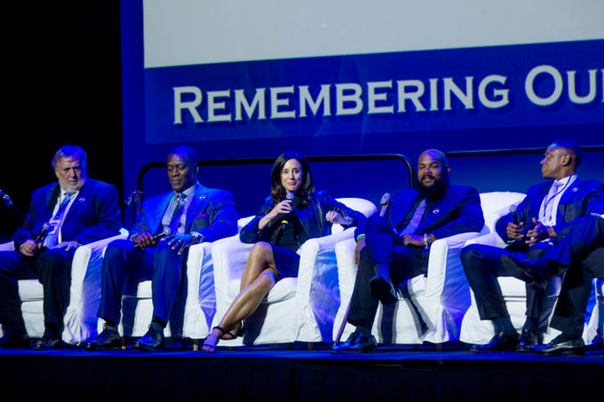 (L to R) Sports journalist Mike McCabe,  former Detroit Lion Robert Porcher, Olympic soccer player Kate Sobrero Markgraf, former MSU running back TJ Duckett and former pro basketball player BJ Armstrong sit on stage during the Michigan Sports Hall of Fame induction ceremony at Motor City Casino in Detroit, MI on September 28, 2018.