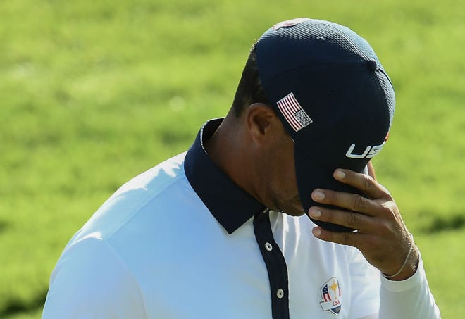 Tiger Woods reacts during his foursomes match on Saturday at the Ryder Cup.