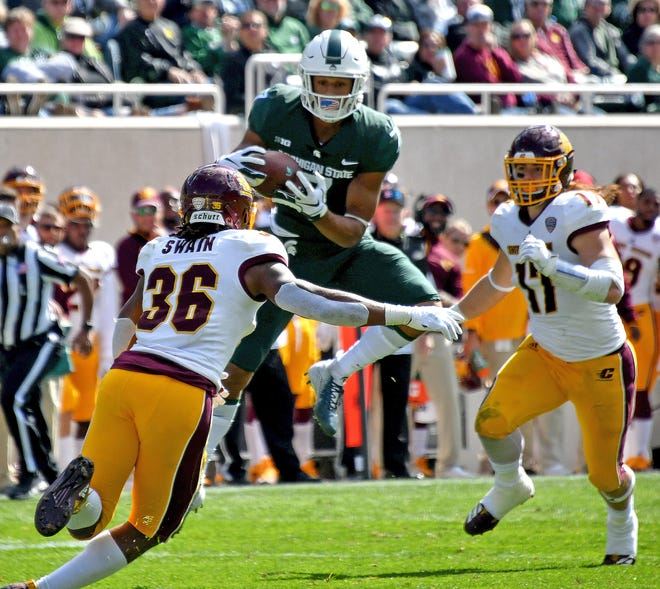 Spartan receiver Cody White pulls in a second quarter pass to set up MSU's second touchdown. He suffered a broken hand later in the game.