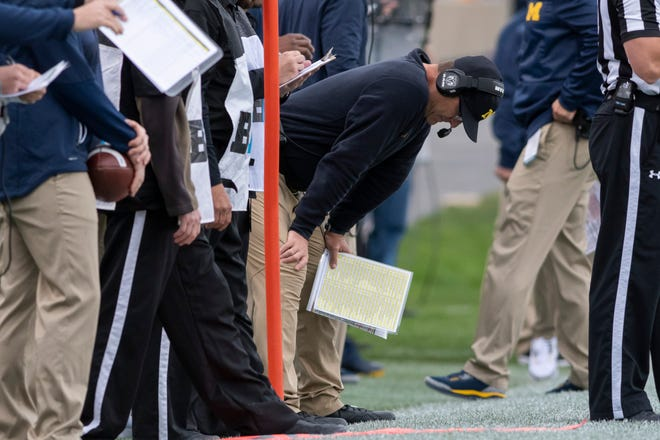 Michigan head coach Jim Harbaugh looks away from the play in the first quarter.