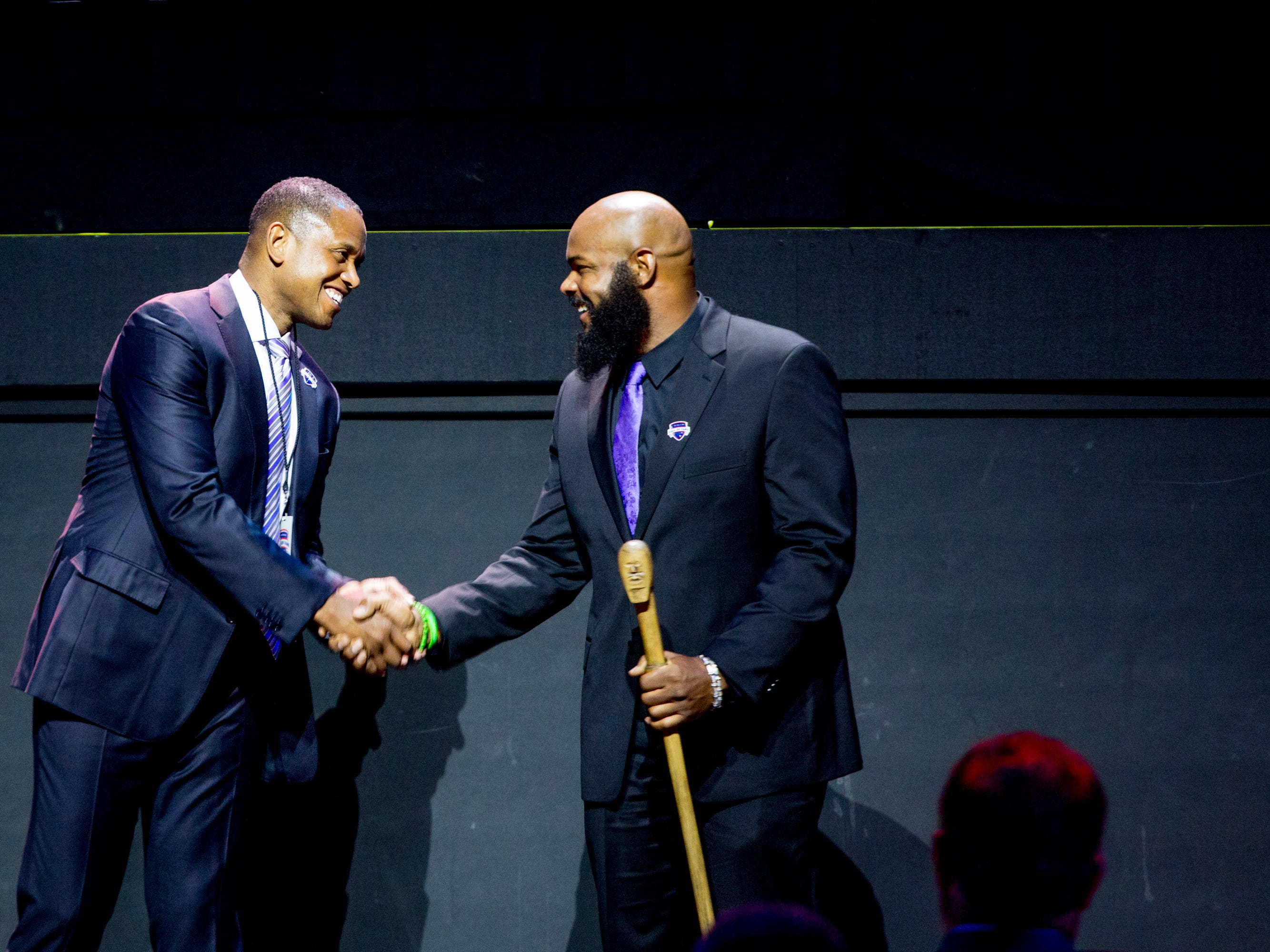 B.J. Armstrong shakes hand with T.J. Ducket during the Michigan Sports Hall of Fame induction ceremony.
