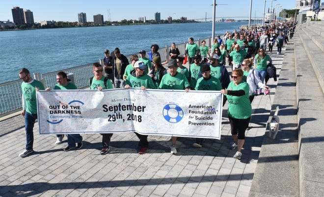 More than 2,500 people joined the walk Saturday along the Detroit River front.