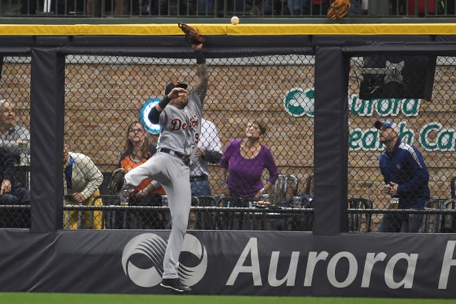 Tigers outfielder Nick Castellanos is unable to catch a home run hit by Brewers' Ryan Braun during the eighth inning on Friday.
