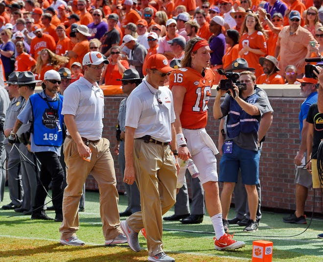 Clemson quarterback Trevor Lawrence leaves the field after being injured during the first half of Saturday's game against Syracuse.