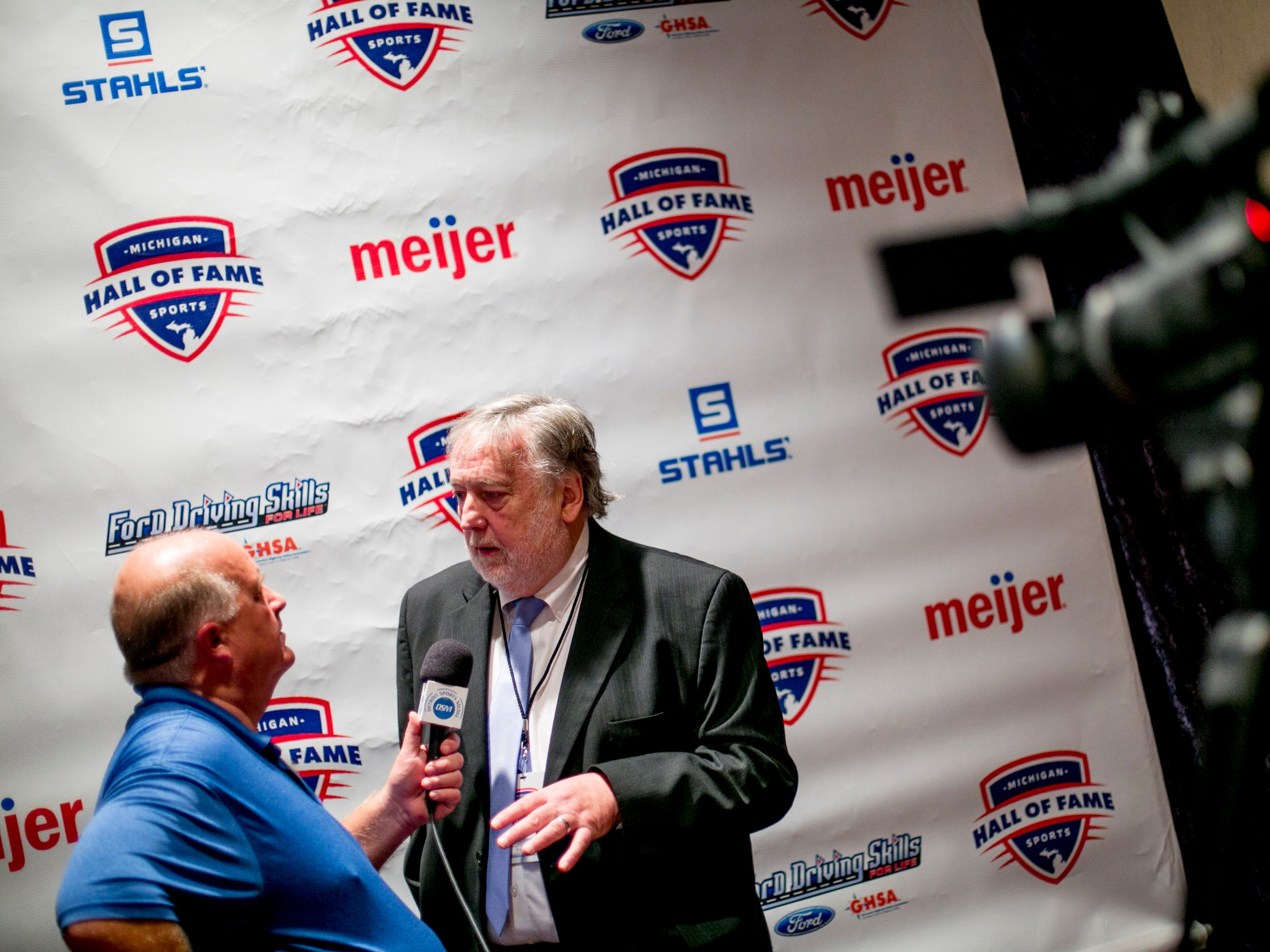 Sports journalis Mick McCabe gives an interview before the ceremony.