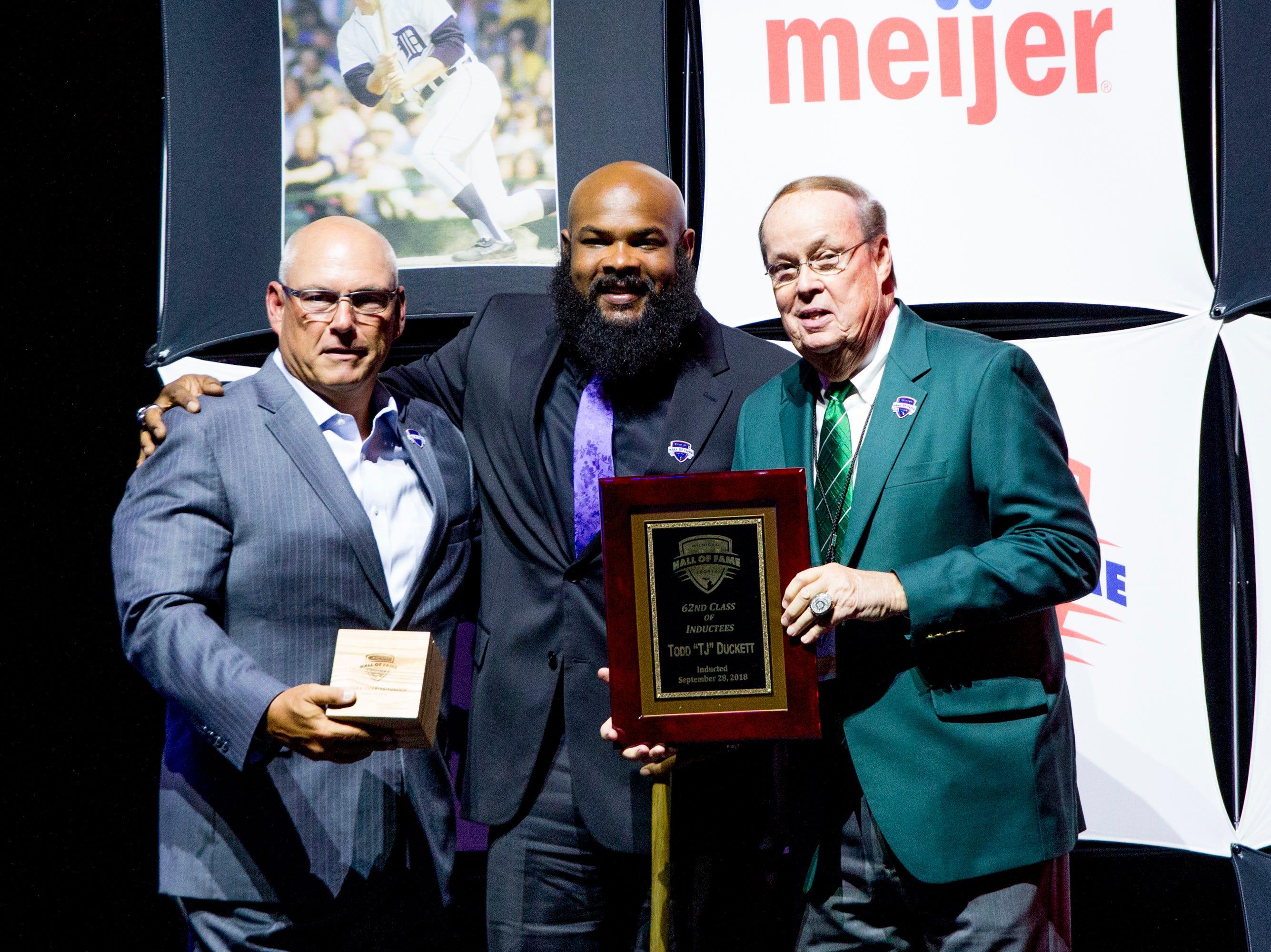 """Former MSU running back Todd """"TJ"""" Duckett receives his award."""