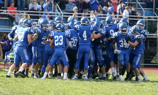 Horseheads football players celebrate their 28-21 win over Corning on Sept. 29, 2018 at Horseheads High School.
