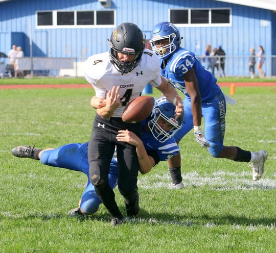 Patrick Clark of Horseheads strips the ball from Max Freeman of Corning to force a turnover during the Blue Raiders' 28-21 win Sept. 29, 2018 at Horseheads High School.