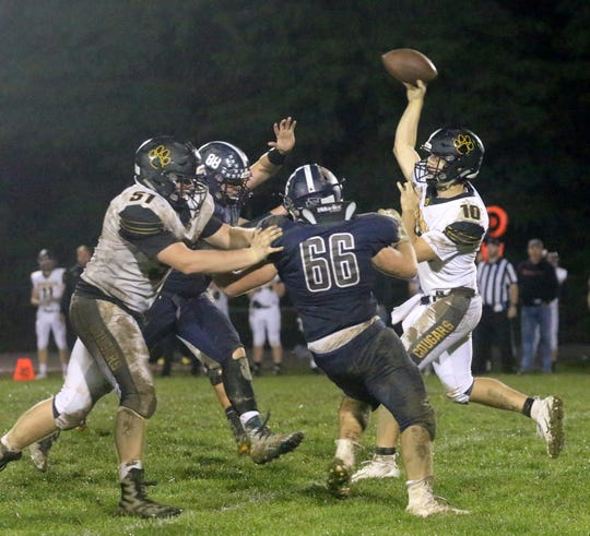 Turner Wilson passes the ball for Honeoye Falls-Lima as Watkins Glen/Odessa-Montour players rush the passer Sept. 28, 2018 at Odessa's Charles Martin Field.